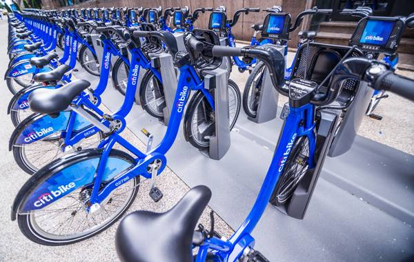 Citi Bike docking station in New York. Citi Bike is a privately owned for-profit public bicycle sharing system that serves New York City; credit: stockelements / shutterstock.com