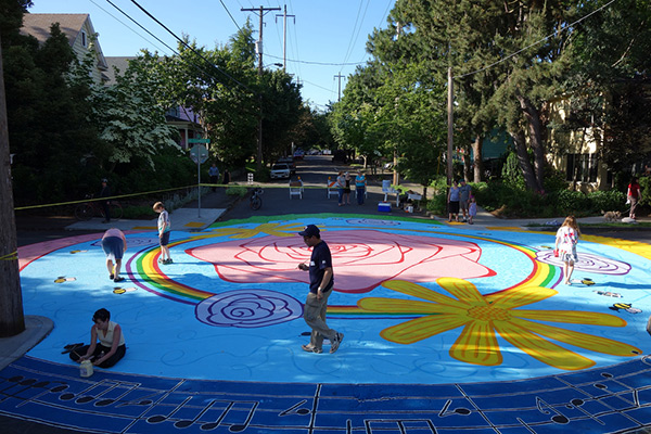 "Newer intersection repair at NE Rodney & Tillamook honoring the identity of Portland as ""The City of Roses"" 