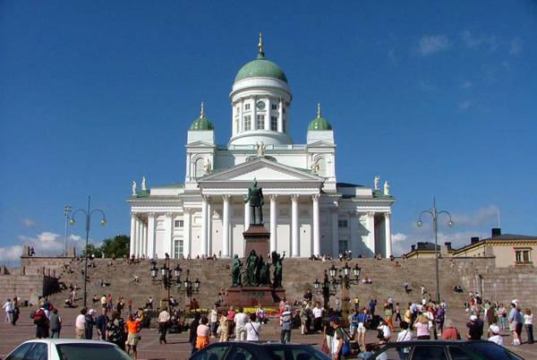 """Creative Commons  The Senate Square in downtown Helsinki, Finland during high tourist season in the summer. The Helsinki Cathedral is on the background, and in the middle of the square the statue of Alexander II of Russia can be seen."".By  Jonik licensed under CC 2.0"