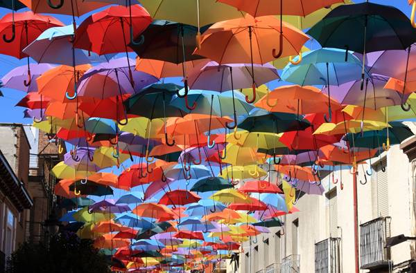 Street decorated with colored umbrellas.Madrid,Ge tafe, Spain; credit Lukasz Janyst / shutterstock.com