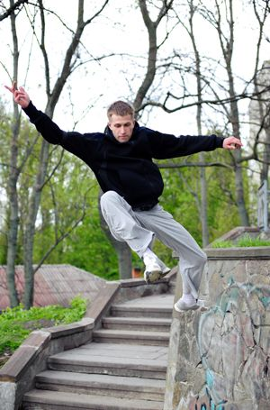 Free runner using the steps to create a new experience and keep fit; credit: shutterstock.com