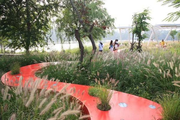 Landscape-Architecture - The red ribbon runs across open the field of a former garbage dump at Qinhuangdao  City, Hebei Province, China. Credit: Turenscape