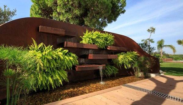 Cor-Ten steel featured heaviliy in this private garden design. Photo credit: Iúri Chagas