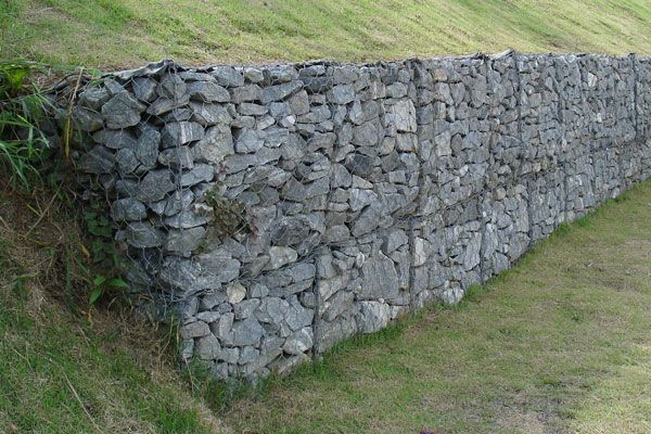 Gabion- corrosion resistant wire containers filled with stone used to build retaining walls, revetments, slope protection, channel linings and other engineering structures. Credit: Eurico Zimbres. Licensed under CC S A 2.5