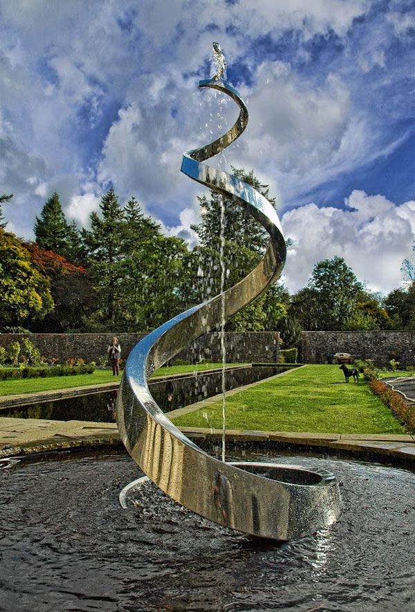Serpent (West) One of a pair of 9ft water sculptures installed at Corsock House. Marine grade stainless steel. Photo credit: Giles Rayner
