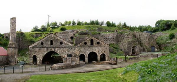 """Blaenafon Ironworks, a Unesco World Heritage site in Wales, UK"". Image licendesd under CC BY-SA 2.0 By Alan Stanton - originally posted to Flickr as Blaenafon Ironworks. https://commons.wikimedia.org/wiki/File:Blaenafon_Ironworks-24May2008.jpg#/media/File:Blaenafon_Ironworks-24May2008.jpg"