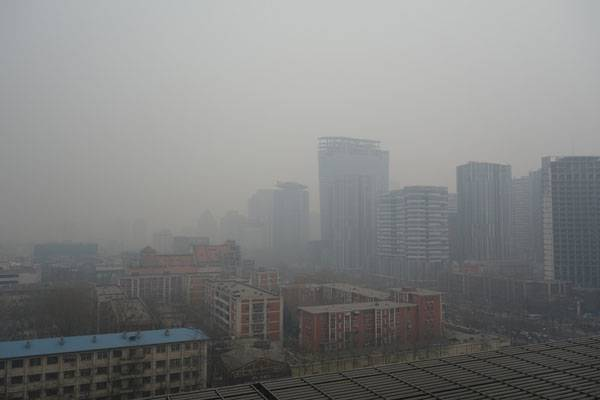 """Are people the leading cause of rising carbon dioxide levels? - Image: """"Beijing Air Pollution..."""" by Kentaro IEMOTO. Licensed under CC BY-SA 2.0 via Flickr"""