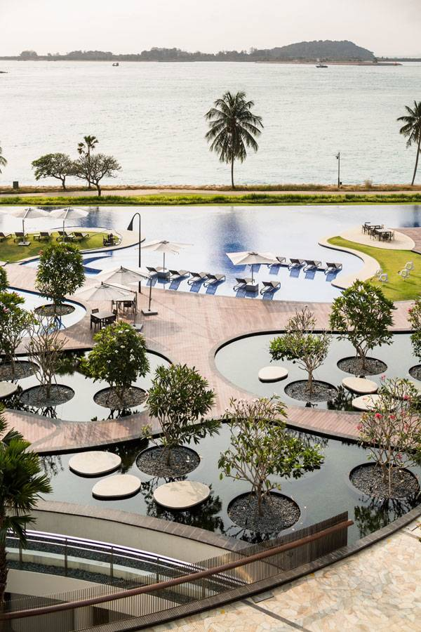 Two different water features, The Reflecting Garden and The Gigantic Pool is divided, yet integrated, by the Floating Terraces, which serves as both pathways and pool decks. Image credit: TROP: terrains + open space