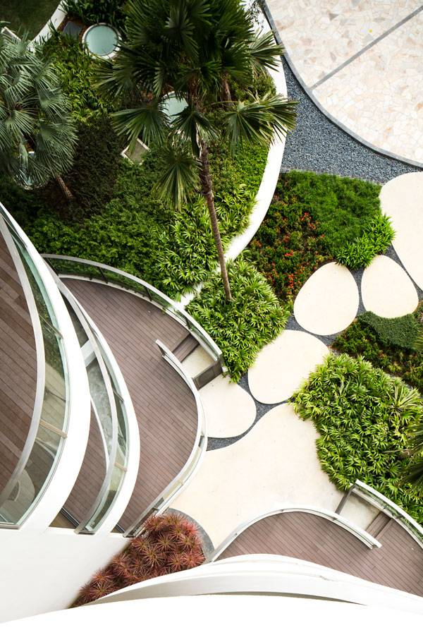 All ground floor units have direct access to the garden. Private pathways are provided to get in and out from private balconies. Image credit: TROP: terrains + open space