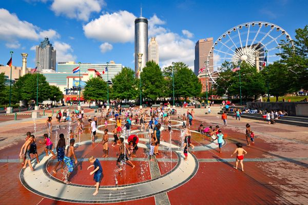 Children play at Centennial Olympic Park in Atlanta, GA. The park commemorates the 1996 Atlanta ; image credit: Sean Pavone / shutterstock.com