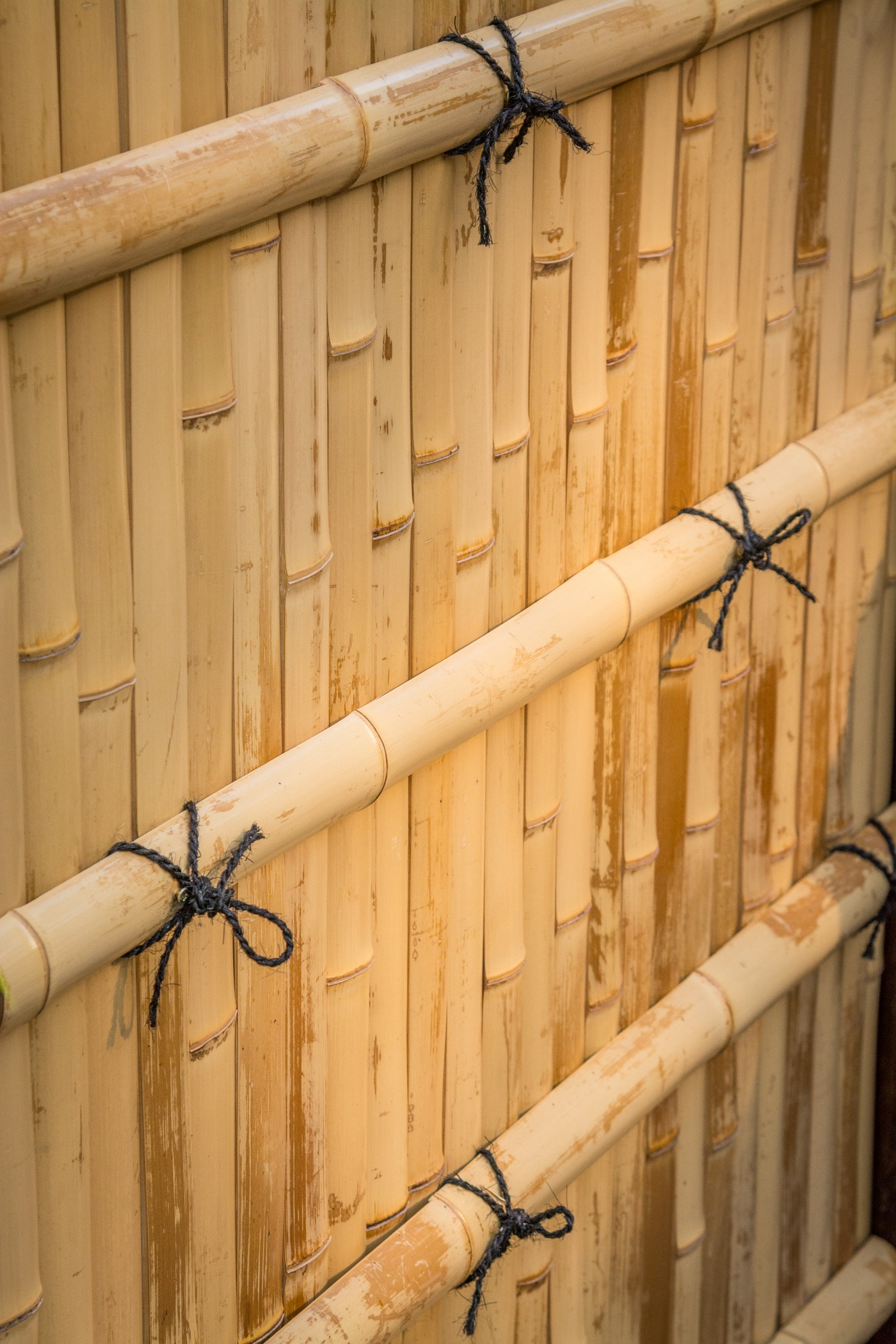 A Kennin-ji style of bamboo fence, created by craftsmen from Miki Bamboo of Kyoto in collaboration with the Portland Japanese Garden's gardening staff, embodies skill in hidden detail.